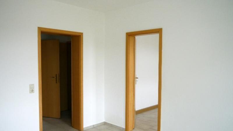 und 1 Wohnung mit 90 m² Wohnfläche